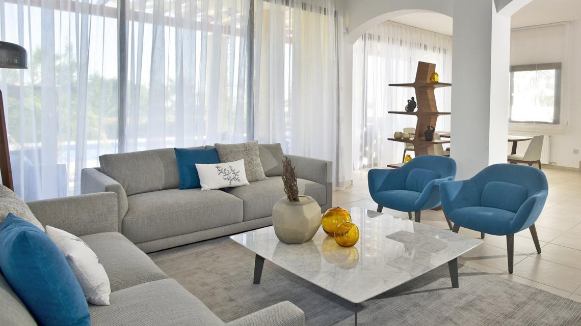 Mid-century, modern, unique, timeless, classy living room by Takis Angelides Furnihome Cyprus