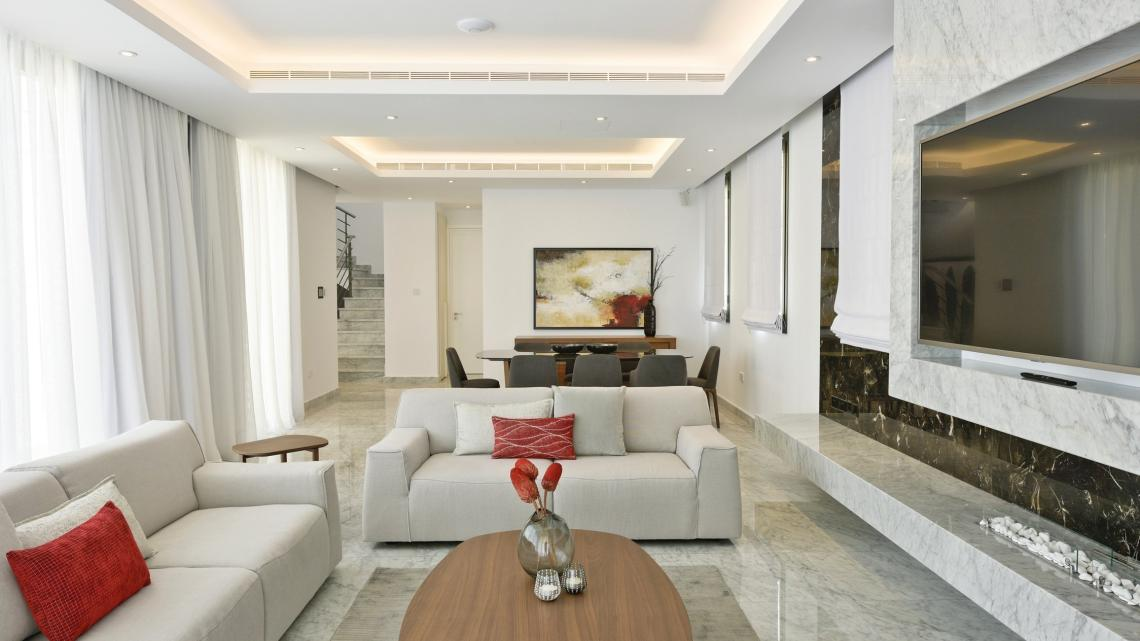 Modern Minimalist sleek simple warm inviting living room by Takis Angelides Furnihome Cyprus